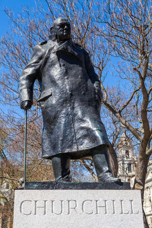 parliament square: A statue of arguably Britain's most iconic Prime Minister Sir Winston Churchill, located on Parliament Square in London. Stock Photo