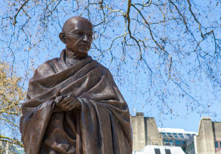 parliament square: A statue of Mahatma Gandhi situated on Parliament Square in London. Stock Photo