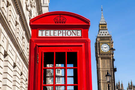 phonebox: An iconic red Telephone Box with Big Ben in the background in London. Stock Photo