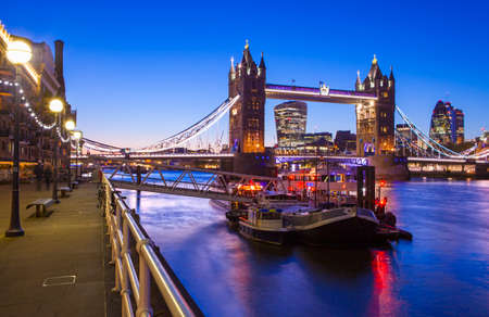 river boat: A beautiful dusk-time view of Tower Bridge and the River Thames in London.