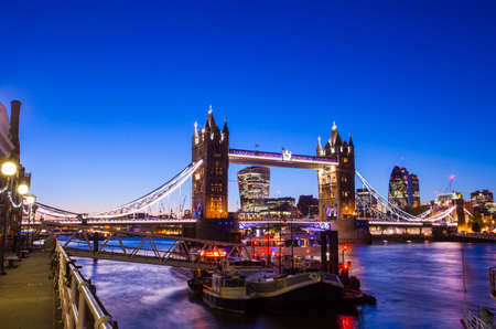 30 st mary axe: A beautiful dusk-time view of Tower Bridge and the River Thames in London.