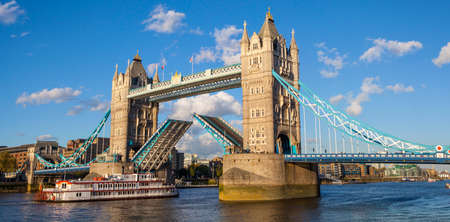 opening up: A panoramic view of Tower Bridge opening up over the River Thames to let a vessel pass underneath.