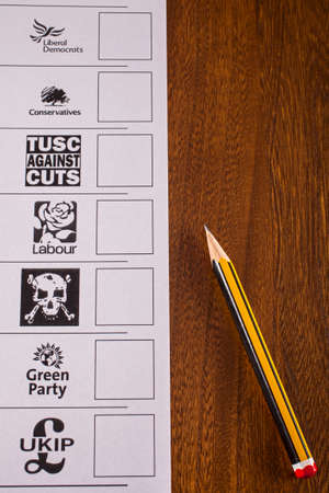 conservatives: LONDON, UK - MAY 7TH 2015: A Ballot Paper and pencil for a UK General Election, on 7th May 2015.