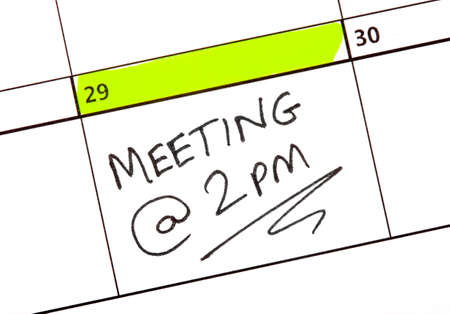 Meeting date highlighted on a Calendar. photo