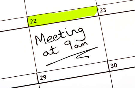 organised group: A Meeting Date highlighted on a Calendar. Stock Photo