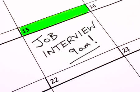 job hunting: A Job Interview date written on a Calendar. Stock Photo