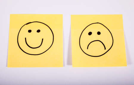 sign post: Happy and Sad Faces on Two Pieces of Memo Paper.