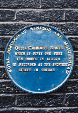 shortest: A blue marking the location of Queen Charlotte Street in Windsor, Berkshire.  Queen Charlotte Street is the shortest street in Great Britain. Editorial