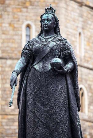 queen victoria: A statue of Queen Victoria outside Windsor Castle in Berkshire, England.