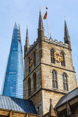 southwark: The tower of Southwark Cathedral with the Shard skyscraper behind in London.