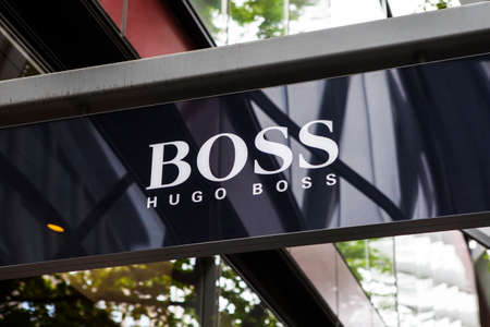 hugo: LONDON, UK - JUNE 10TH 2015: A sign on the shopfront of a Hugo Boss retail outlet in central London, on 10th June 2015. Editorial