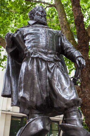 churchyard: A statue of famous explorer Captain John Smith, located in Bow Churchyard in London. Editorial