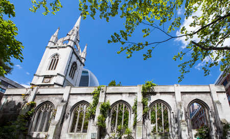 bombings: The ruins of the historic St. Dunstan-in-the-East church in the City of London.  The church was destroyed during enemy action in 1941 and has since been turned into a public garden.  The Walkie Talkie skyscraper (20 Fenchurch Street) can be seen in the ba Stock Photo