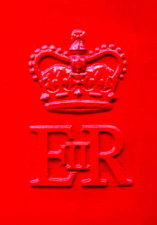 post office: The Queen Elizabeth Royal Crest on a red Post Box in the United Kingdom.