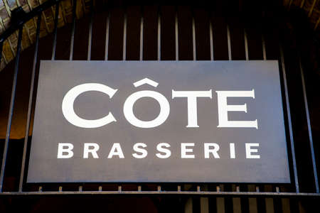 brasserie: LONDON, UK - JUNE 7TH 2015: A sign for a Cote Brasserie Restaurant in central London on 7th June 2015.