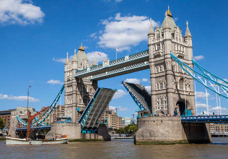 opening up: A view of the magnificent Tower Bridge opening up to let a Tall Ship pass underneath in London.