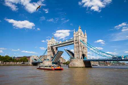 river thames: A view of the magnificent Tower Bridge opening up over the River Thames in London. Editorial