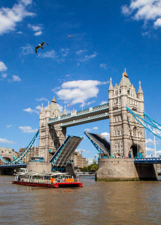 A view of the magnificent Tower Bridge opening up over the River Thames in London.