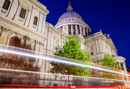st   pauls cathedral: A night-time view of light trails passing the historic St. Pauls Cathedral in London.