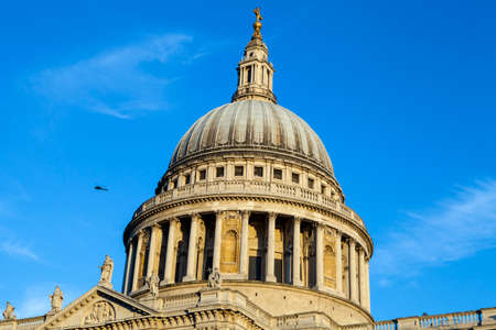 st pauls: A helicopter flying over the historic St. Pauls Cathedral in the City of London. Editorial