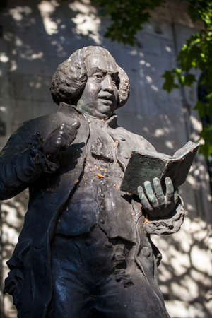 essayist: A statue of famous Briton, Dr Samuel Johnson located outside St. Clement Danes church on the Strand in London.
