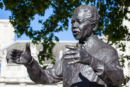 Staue of historic South African leader Nelson Mandela in Parliament Square, London.