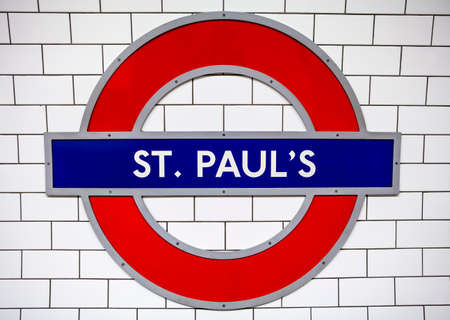 st pauls: LONDON, UK - JUNE 29TH 2015: The sign for St. Pauls Underground Station in the City of London, on 29th June 2015. Editorial