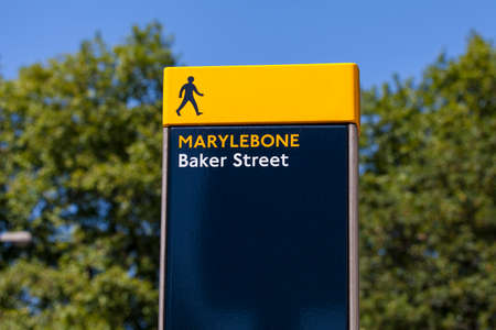 streetsign: A pedestrian sign on Baker Street in London.