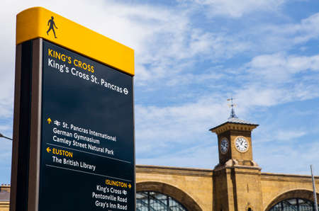places of interest: A pedestrian sign in Kings Cross identifying local places of interest.  The main building of Kings Cross Station can be seen in the distance.