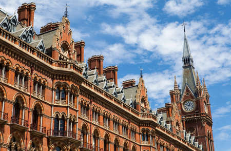 clocktower: LONDON, UK - JULY 10TH 2015: The former Midland Grand Hotel in Kings Cross, London on 10th July 2015.  The building now houses the luxury St. Pancras Renaissance London Hotel.
