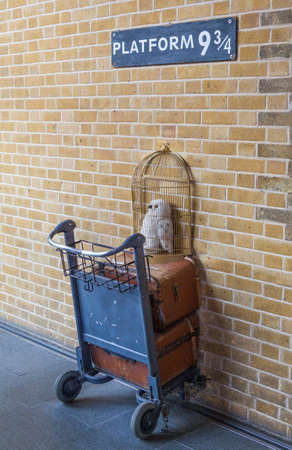34: LONDON, UK - JULY 10TH 2015: Platform 9 34 at Kings Cross Train Station made famous in the Harry Potter movies, in London on 10th July 2015. Editorial