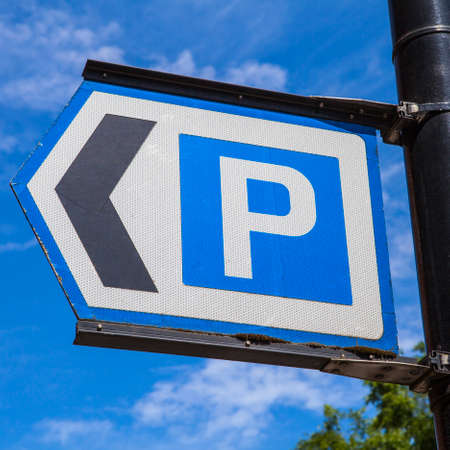 enforce: A sign directing vehicles to the nearest Car Park.