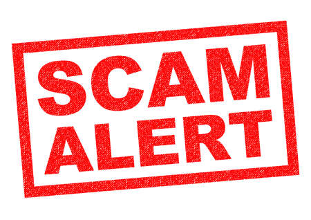 SCAM ALERT red Rubber Stamp over a white background.
