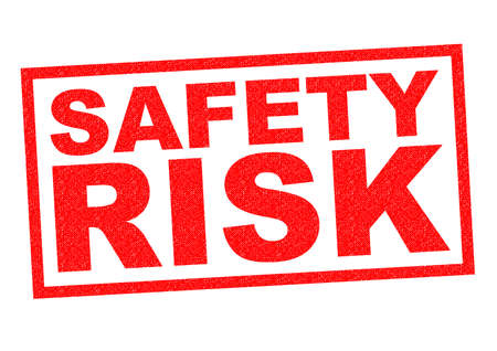 alarming: SAFETY RISK red Rubber Stamp over a white background.