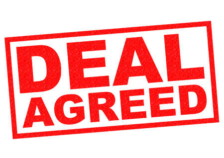 barter: DEAL AGREED red Rubber Stamp over a white background. Stock Photo
