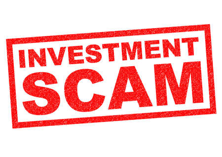 hoax: INVESTMENT SCAM red Rubber Stamp over a white background.