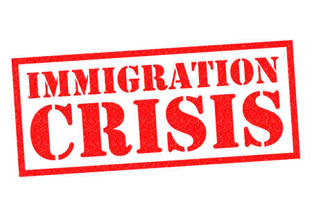 IMMIGRATION CRISIS red Rubber Stamp over a white background.