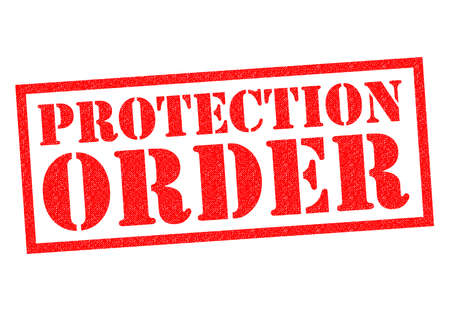 restraining: PROTECTION ORDER red Rubber Stamp over a white background.