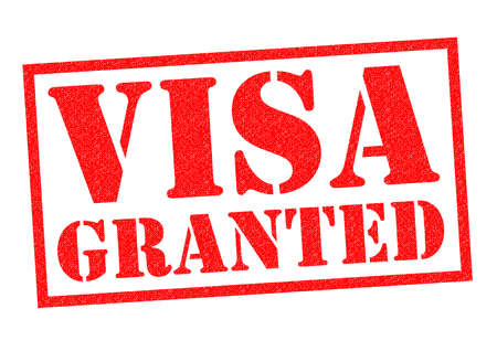 granted: VISA GRANTED red Rubber Stamp over a white background. Stock Photo