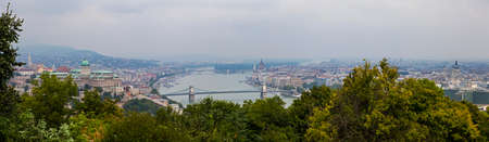 matthias church: A panoramic view of Budapest from Gellert Hill.  The view takes in many sights including the Hungarian Parliament Building, Buda Castle, Matthias Church, St. Stephen's Basilica and the River Danube.