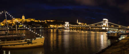halaszbastya: A panorama showing the beautiful Budapest skyline over the River Danube.  The sights include Buda Castle, the Chain Bridge and the Fisherman's Bastion.