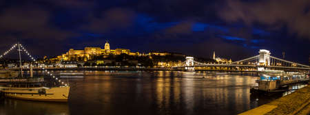 the chain bridge: A panorama showing the beautiful Budapest skyline over the River Danube.  The sights include Buda Castle, the Chain Bridge and the Fisherman's Bastion. Editorial