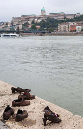 'second world war': BUDAPEST, HUNGARY - AUGUST 19TH 2015: The Shoes on the Danube Bank Memorial in Budpaest, on 19th August 2015.  The memorial honors the Jews who were killed by fascist Arrow Cross Militia during the Second World War. Editorial