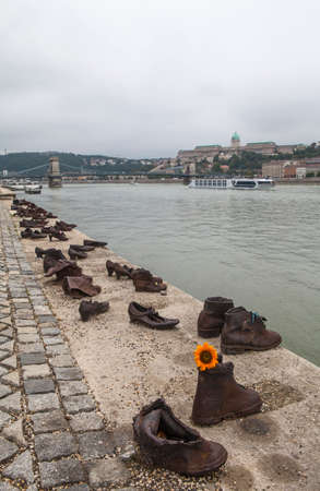 honors: BUDAPEST, HUNGARY - AUGUST 19TH 2015: The Shoes on the Danube Bank Memorial in Budpaest, on 19th August 2015.  The memorial honors the Jews who were killed by fascist Arrow Cross Militia during the Second World War. Editorial
