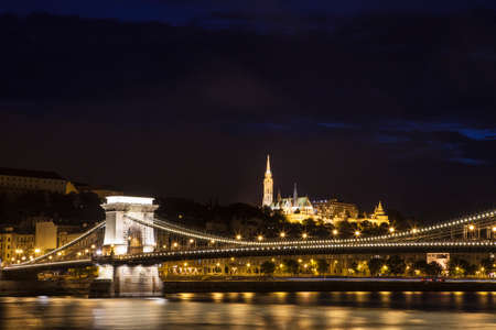 matthias church: A beautiful night-time view of the Chain Bridge spanning the River Danube with the Fishermans Bastion and St. Matthias Church in the background.