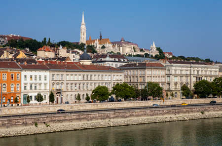 halaszbastya: A view of the spire of Matthias Church and the Fisherman's Bastion from the Chain Bridge in Budapest, Hungary. Stock Photo