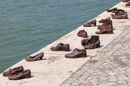 'second world war': The Shoes on the Danube Bank Memorial in Budpaest.  The memorial honors the Jews who were killed by fascist Arrow Cross Militia during the Second World War, Editorial