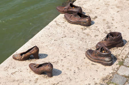 militia: The Shoes on the Danube Bank Memorial in Budpaest.  The memorial honors the Jews who were killed by fascist Arrow Cross Militia during the Second World War, Editorial