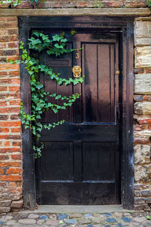 old english: A rural-looking doorway in an old English town or village. Stock Photo