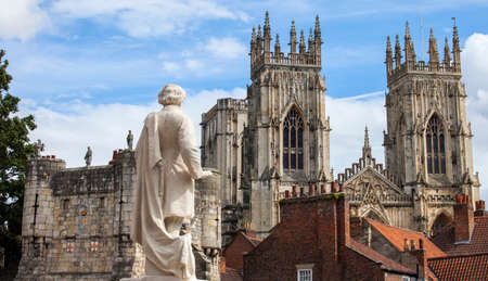 york minster: A view from the York Art Gallery taking in the sights of the William Etty statue, Bootham Bar and the towers of York Minster in York, England.